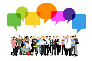 Graphic of crowd of people with coloured speech bubbles above them
